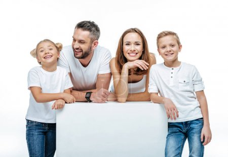 Cheerful family with blank white card