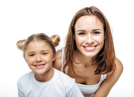 Photo for Smiling mother and daughter having fun together and looking at camera isolated on white - Royalty Free Image