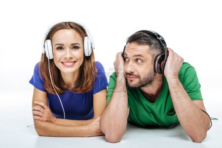 Couple in headphones listening to music