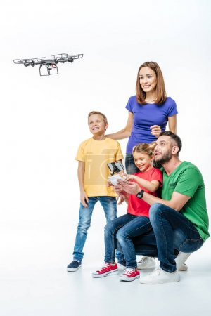 Photo for Family using hexacopter drone isolated on white - Royalty Free Image