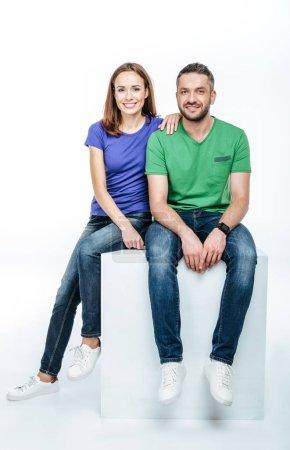Young couple looking at camera