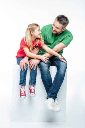 Photo for Father with daughter sitting and having fun isolated on white - Royalty Free Image