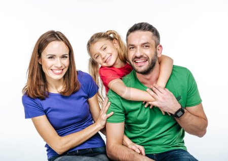 Young family in colorful t-shirts