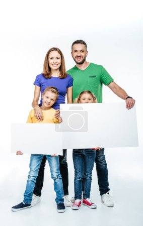 family standing with blank white cards