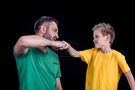 Father and son touching fists