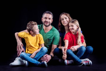Happy family in colored t-shirts