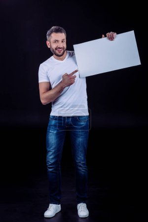Smiling man holding blank card