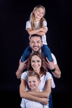 Happy family in white t-shirts having fun together...