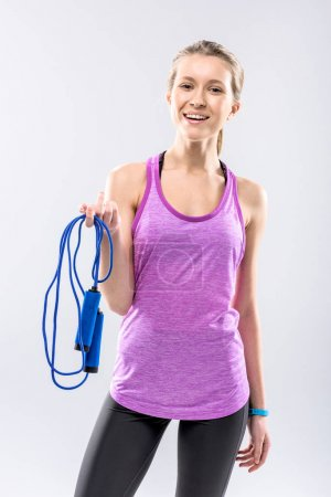 Woman exercising with skipping rope