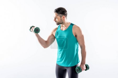 Photo pour Athletic man in sportswear exercising with dumbbells isolated on white - image libre de droit