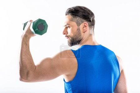 Photo pour Young muscular man exercising with dumbbell isolated on white - image libre de droit