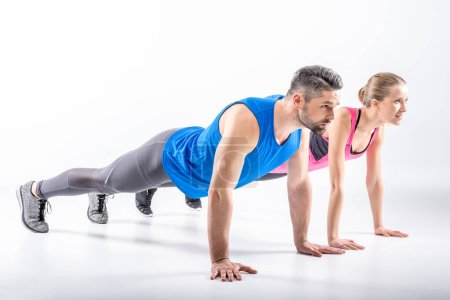 Couple doing plank exercise