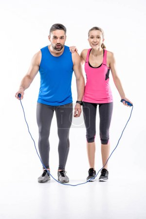 Sportive couple with skipping rope