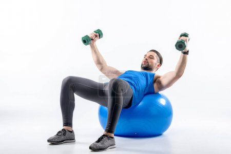 Man exercising on fit ball