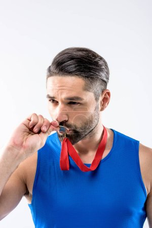 Man with gold medal award
