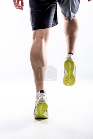 Legs of man in sneakers