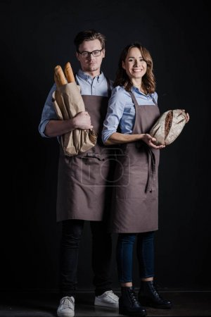 Bakers holding bread