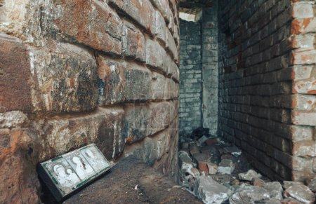 Inside in the old, burnt, destroyed, abandoned church with brick walls