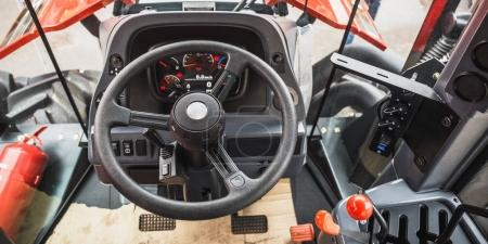 Harvester machine inside cabin, control panel, levers, steering wheel