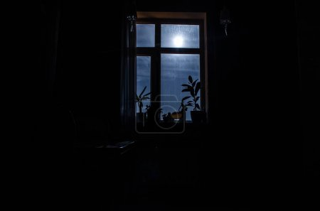 Photo for Night scene of moon seen through the window from dark room. Moonlight inside dark room - Royalty Free Image