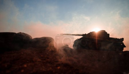 Photo for War Concept. Military silhouettes fighting scene on war fog sky background, World War Soldiers Silhouettes Below Cloudy Skyline at sunset. Attack scene. Armored vehicles. German tank in action - Royalty Free Image