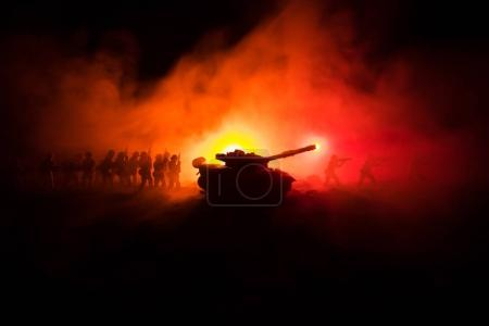 Photo for War Concept. Military silhouettes fighting scene on war fog sky background, World War Soldiers Silhouettes Below Cloudy Skyline At night. Attack scene. Armored vehicles. Tanks battle. Decoration - Royalty Free Image