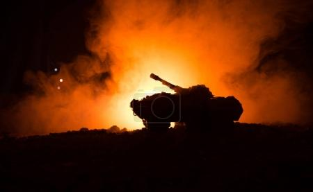 War Concept. Military silhouettes fighting scene on war fog sky background, World War German Tanks Silhouettes Below Cloudy Skyline At night. Attack scene. Armored vehicles.