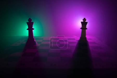 Photo for Chess board game concept of business ideas and competition and strategy ideas concep. Chess figures on a dark background with smoke and fog. Business leadership and confidence concept. Selective focus - Royalty Free Image