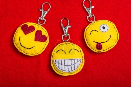 Yellow laughing happy smiley key rings - emoticons.