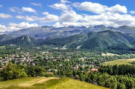 Tatra Mountains, panoramic view from the hiking trail, vista on valley with city in Carpathians
