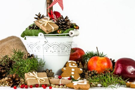 Table with christmas decoration, food, christmas gift, candy, gingerbread man