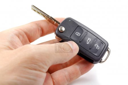 Opened ignition key with immobilizer in man's hand...