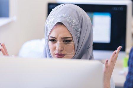 Arabian woman looks angry in office