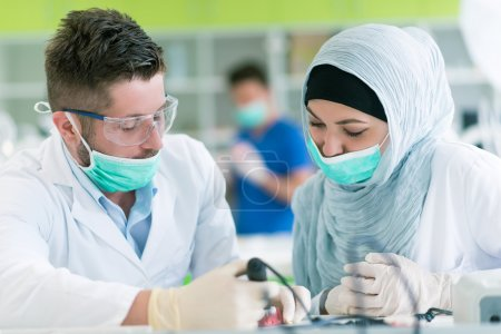 Dental prosthesis students working on the denture