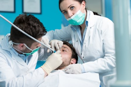 dentist doctor teacher explaining treatment procedure
