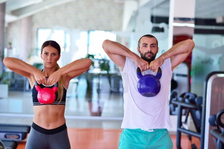 Kettlebells swing exercise at gym