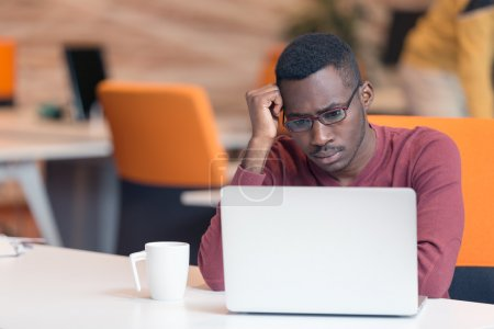 Handsome African American man looking at screen