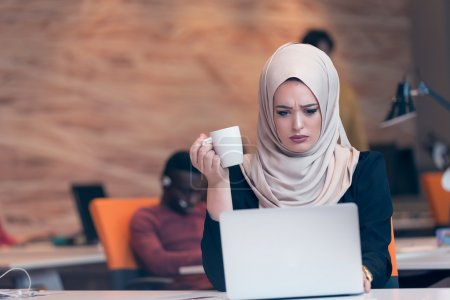 Young Arabic business woman working startup office.