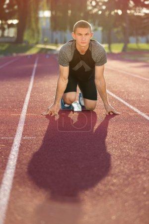 Track runner in starting position