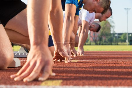 Male athletes at starting line