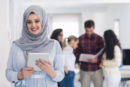 Arabic business woman using digital tablet