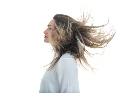 Woman with the waving hair on a white background
