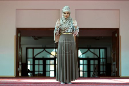 Muslim Woman Praying In Mosque