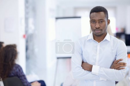 Confident businessman at meeting in office