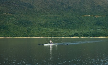 single rower on lake