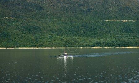Single rower on lake
