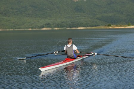 Child rowing on single kayak
