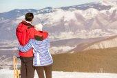 loving couple at snowed mountain range