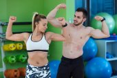 aucasian man and woman in gym