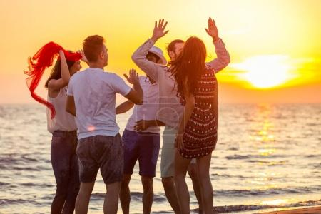 Young People Dancing On Beach